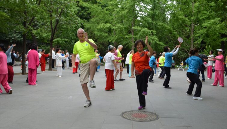 Heiko-Lade-getting -a-personal-lesson-from-local Bejing-resident