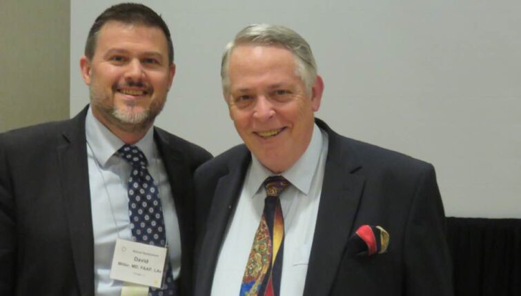 Dr John McDonald (right) presenting at the American Academy of Medical Acupuncture conference in Kansas City with David Miller